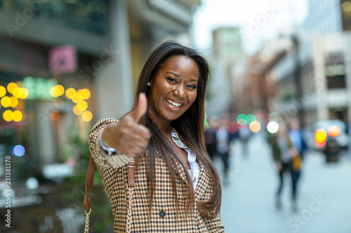 happy young business woman showing a thumbs up Canvas Print