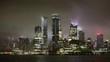 Manhattan skyline during rain, clouds sky.