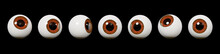 Many Realistic Human Eyes With Brown Iris, Isolated On Black Background