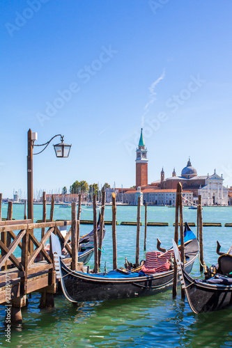 Spoed Foto op Canvas Gondolas gondolas on the dock in Venice
