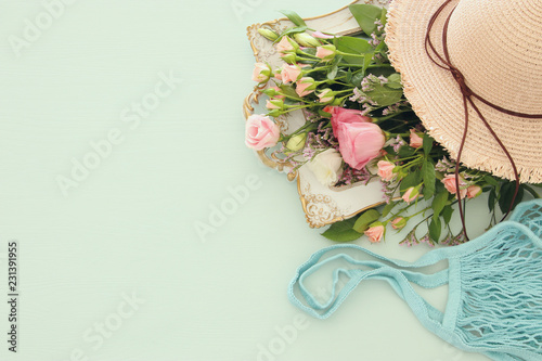 Image of aromatic flowers over pastel wooden table.