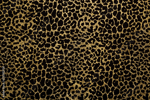 Obraz na plátne Black fabric with golden leopard fur print