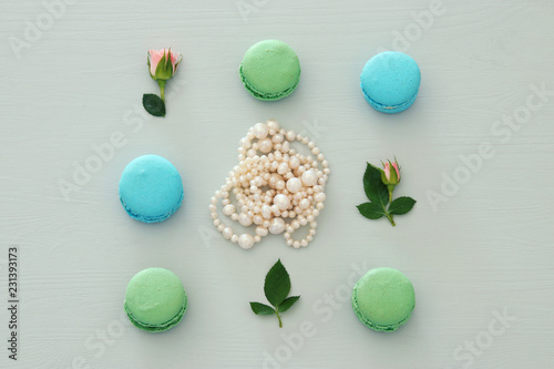 Top view of colorful macaron or macaroon over pastel background. Flat lay.