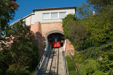 Austria. Graz. Red Cable Car On Schlossberg Hill On A Summer Day