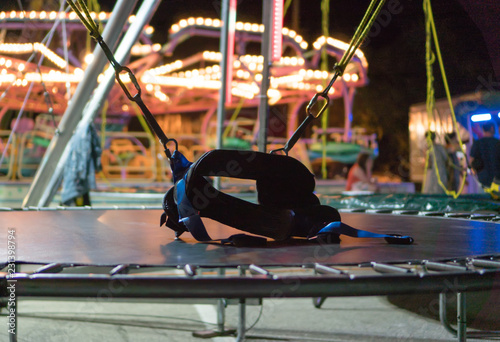 Foto Bungee trampoline in amusement park at night.