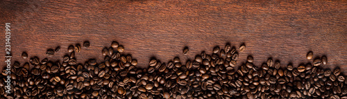 fresh-roasted-coffee-beans-on-natural-dark-oak-wood-panorama-background