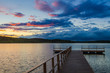 Wooden pier. Clouds over the lake. Lake. Sunset of the day.
