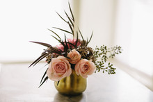 Roses In Small Gold Vase With Greens