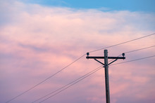 Telegraph Pole And Wires At Sunset