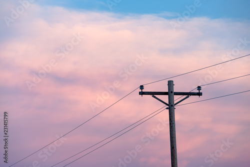 Telegraph pole and wires at sunset Fototapeta