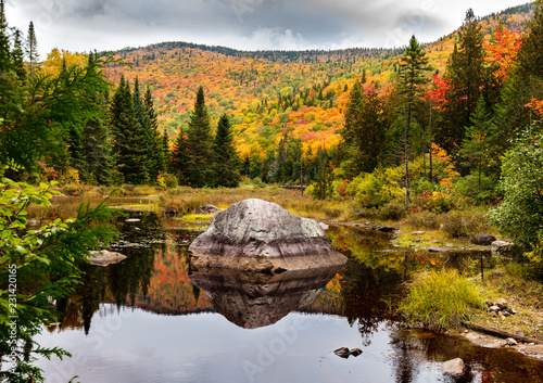 Photo Fall colors of Lac Legault with Mont Kaaikop in the background, in cottage country in the Laurentians, Quebec, Canada