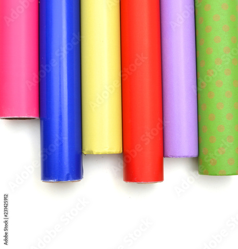 Photo  Rolls of colorful wrapping paper on white background