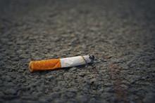 Closeup Of Smoking Cigarette B...