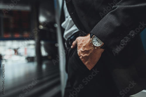 Close up of a hand of a businessman holding it in a pocket while going to work
