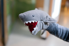 Stuffed Shark Toy On The Child...