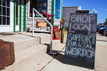 Shop Local Sign Written In Cha...