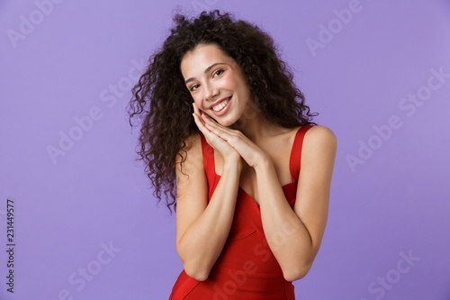 Portrait of a cheerful woman with dark curly hair