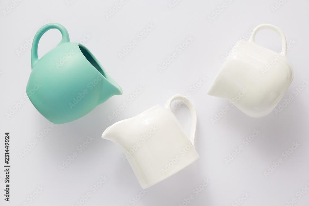 Fototapety, obrazy: empty cream jug on white background