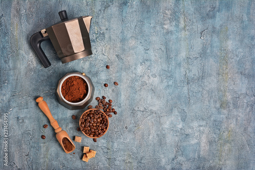 Fototapeta  Top view on open geyser coffee maker with ground coffee and beans for morning es