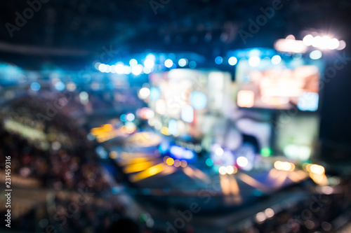Fotografie, Obraz  Blurred background of esports event at big arena with a lot of lights and screens