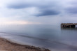 An abandoned pier on the Tuscan sea in Autumn at sunset with long exposure effect - 2