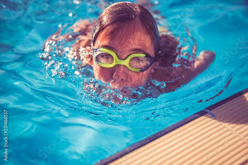 Girl rising from swimming pool - Buy this stock photo and ...
