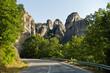 Huge rocks above road at Meteora valley near Kalambaka, Thessaly, Greece
