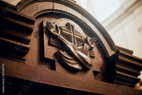 Photo Wooden window of confessional box at church