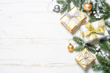 Christmas Background With Gold And Silver Decorations On White.