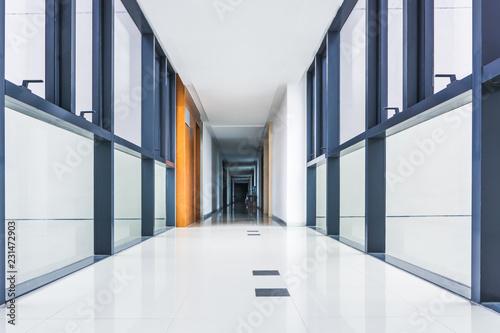 Fotografie, Tablou  Illuminated long corridor in modern office building