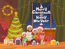 Merry Christmas And Happy New Year. Family At The Dressed Christmas Tree Celebrates The Holiday