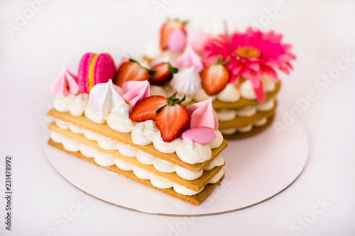Fotografie, Obraz  Tasty beautiful pink cake with strawberries, marshmallows, macaroons and huge fl