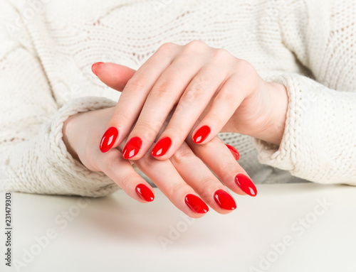 young woman with red manicure on nails Canvas Print