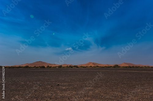 Deurstickers Chocoladebruin View of Merzouga dunes and black desert, southern Morocco