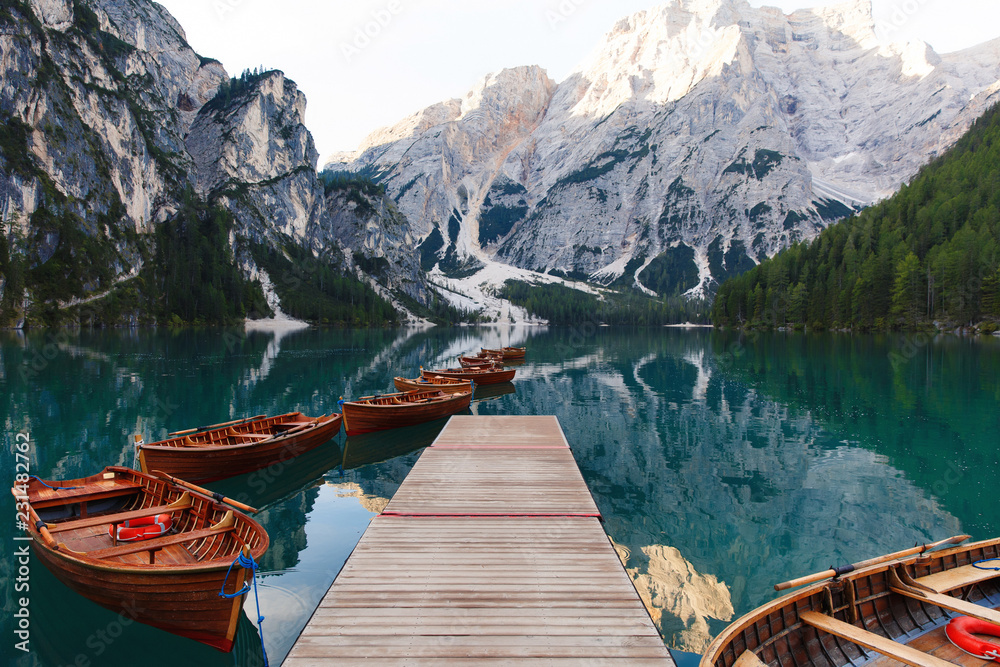 Fototapety, obrazy: Beautiful landscape of Braies Lake (Lago di Braies), romantic place with wooden bridge and boats on the alpine lake, Alps Mountains, Dolomites, Italy, Europe