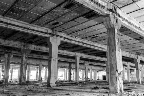 Foto op Plexiglas Oude verlaten gebouwen Abandoned factory interior in Romania in black and white, after the communist regim most of the factories were abandoned.