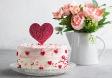 Close Up Of A Cake Decorated With Small Hearts With Heart Cake Topper, Against A Gray Background. Romantic Love Concept. Valentine's, Mother's Day, Birthday Cake Card Background. Horizontal.