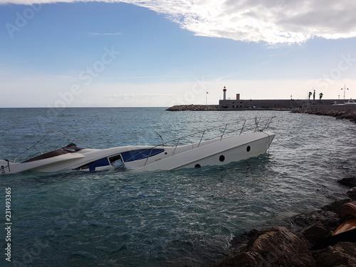 фотография  Luxury Yacht Half Sunken