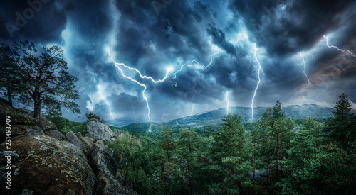 Deurstickers Onweer Lightning thunderstorm flash in the mountains. Concept on topic weather, cataclysms (hurricane, Typhoon, tornado, storm)