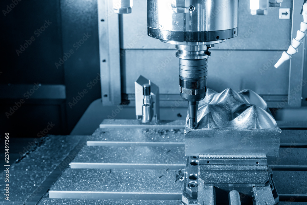 Fototapety, obrazy: The  CNC milling machine cutting the mold part with the index-able ball end mill .The hi-Technology manufacturing process.