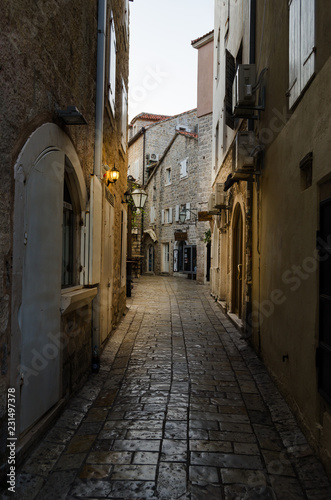 Narrow streets of the old stone town with stone blocks.