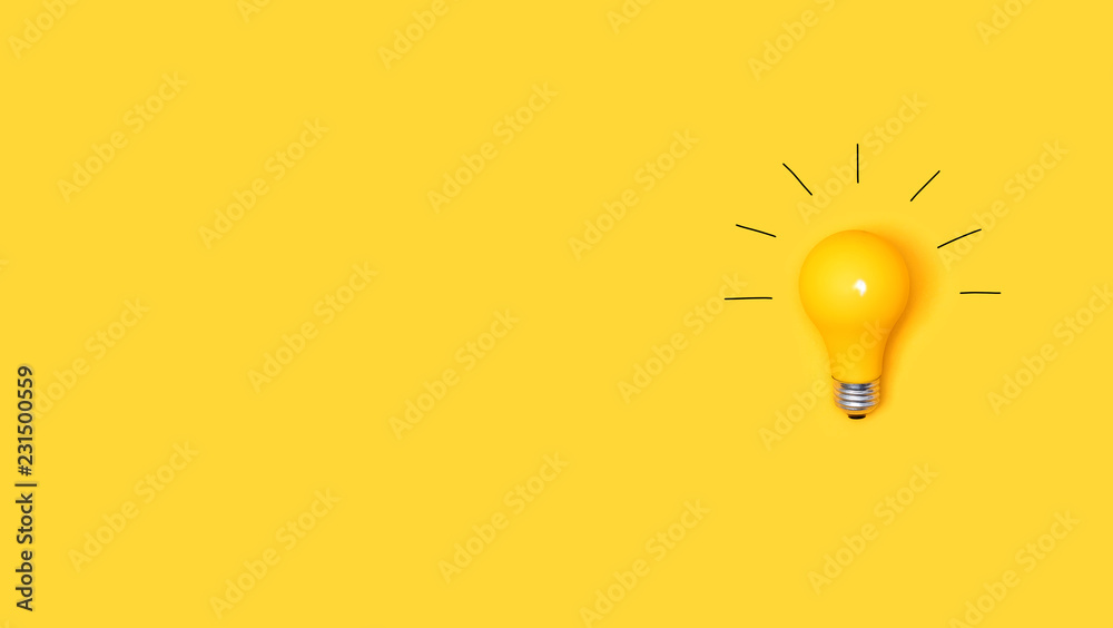 Fototapeta Idea light bulb on a vivid yellow background