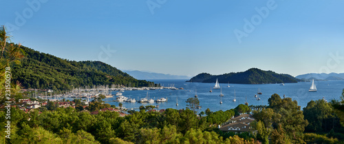 Photo Panoramic view of bay and city of Gocek - Fethiye, Turkey with marina and yachts