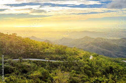 Foto auf Gartenposter Gelb Schwefelsäure idyllic landscape of the Cuban province at sunset, roads on the hillsides leading to the coast