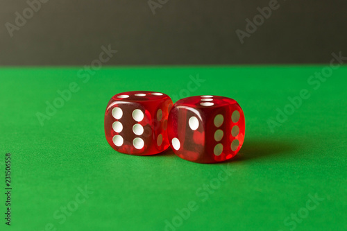 фотография  Dice on a green background . Game concept. Games of chance