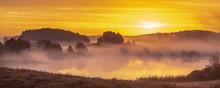 Misty, Multicolored Sunrise Over  Lake In Poland