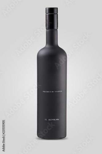 closed matt black bottle of vodka on white background with shadow