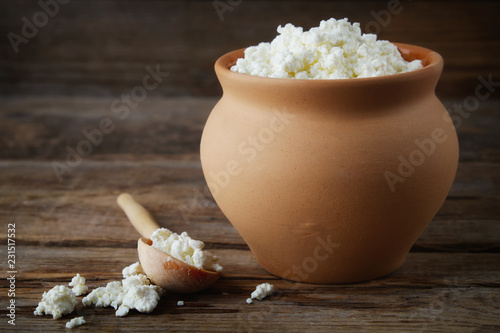 Cottage cheese in rustic vintage clay pot.
