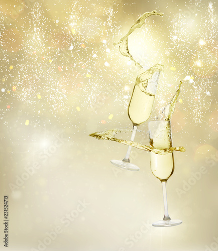 Two festive champagne glasses levitating on golden bokeh background with lights