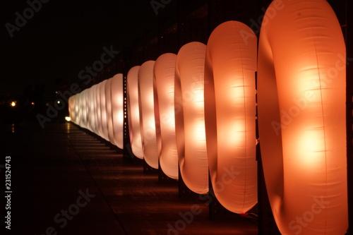 Foto op Canvas Baksteen 光る浮き輪のイメージ